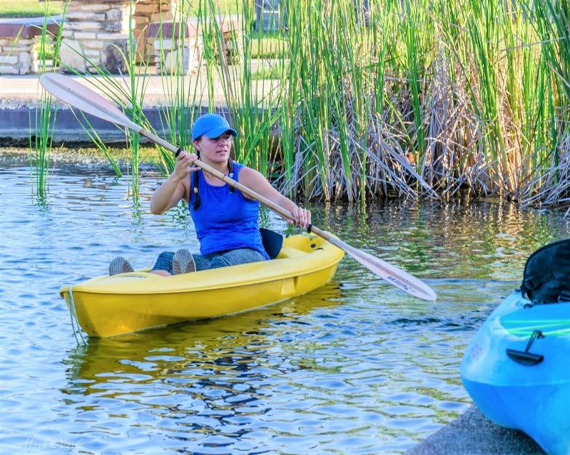 Gabby Anglin paddles in kayak