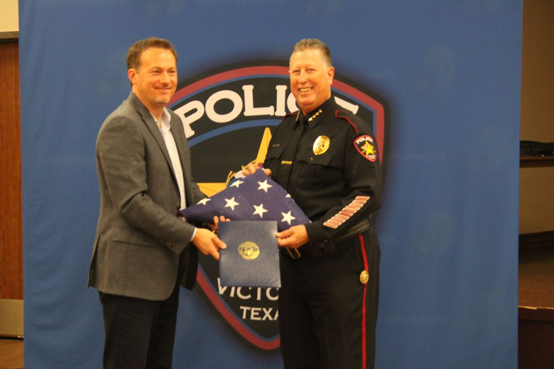U.S. Representative Michael Cloud presents Victoria Police Department Chief J.J. Craig with an Ameri