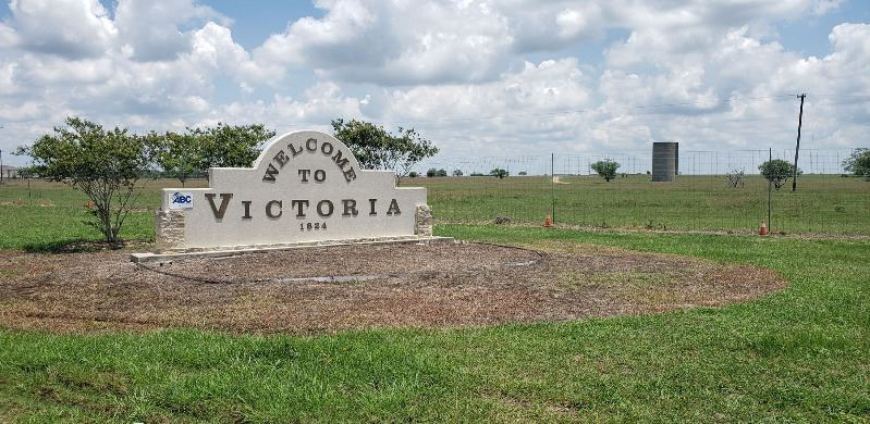 Welcome to Victoria sign with vegetation cleared away