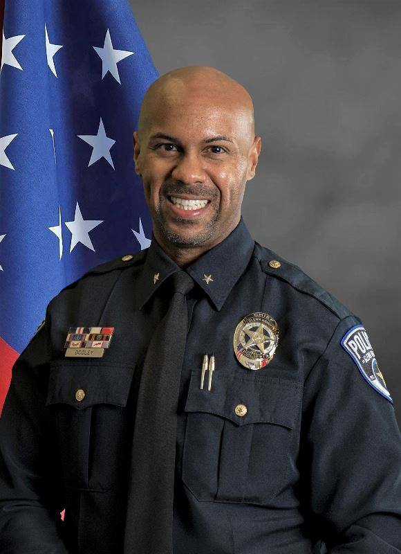 Vernell Dooley Jr. in police uniform